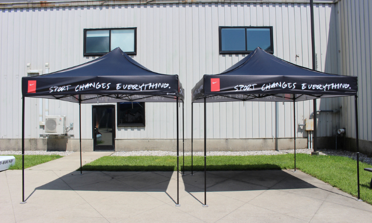 An example of two black, Nike-branded mightyTENTS outside the tentCraft headquarters.