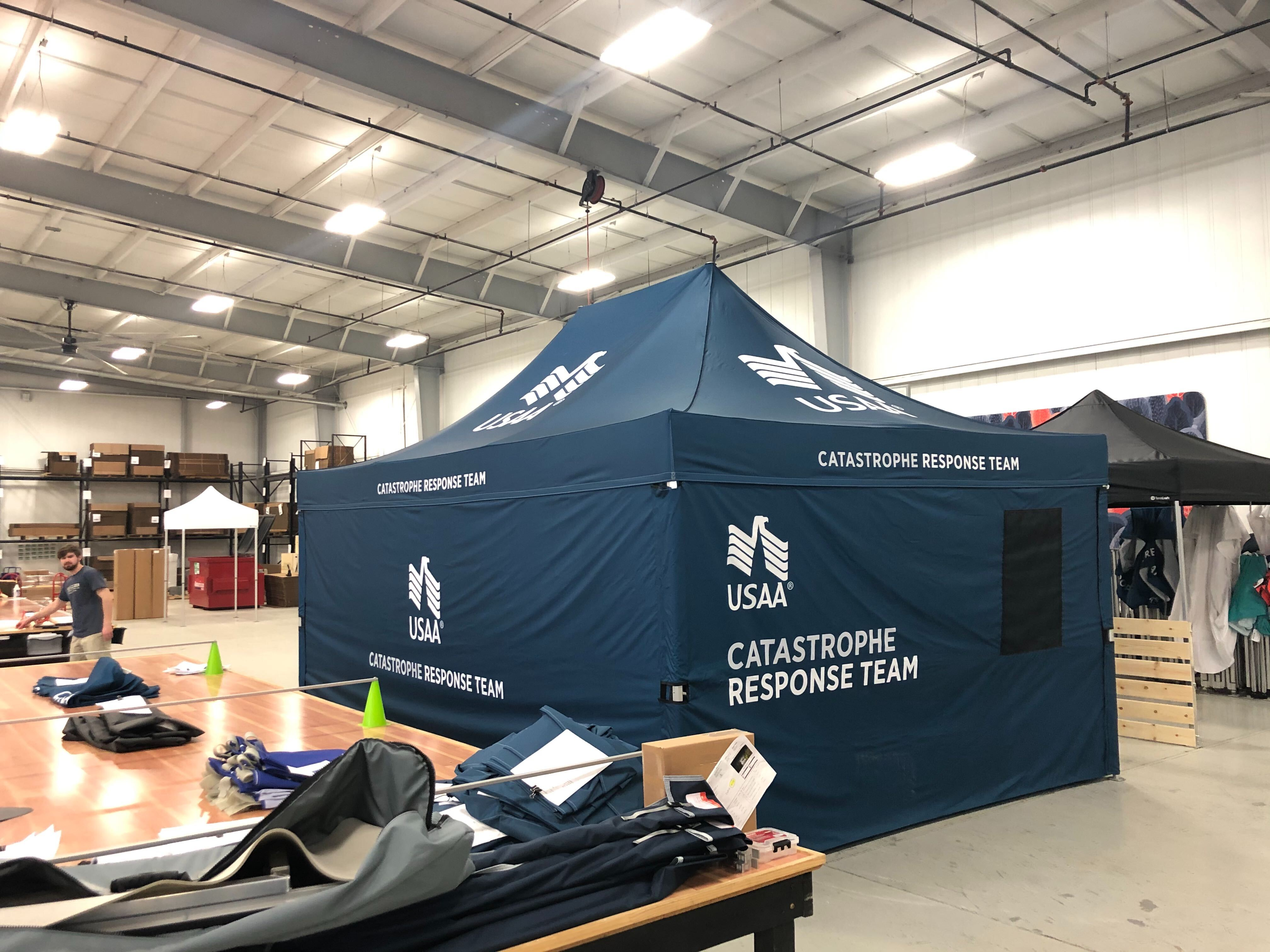 Navy blue pop-up medical tent shelter with USAA custom logo printing and words Catastrophe Response Team